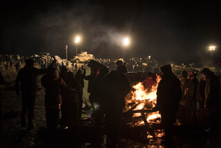 Peaceful protestors gather around a fire at Standing Rock Native American Reservation in North Dakota and South Dakota. Many Syracuse University community members have joined in the efforts to protest against the Dakota Access Pipeline.